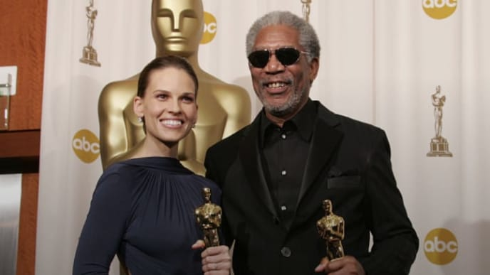 Hillary Swank and Morgan Freeman with their Oscars