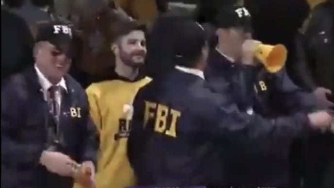 VCU fans troll LSU coach Will Wade by dressing up as FBI agents.