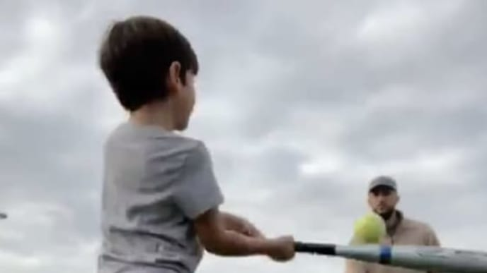 Former Tampa Bay Rays infielder Trevor Plouffe throws batting practice to his son