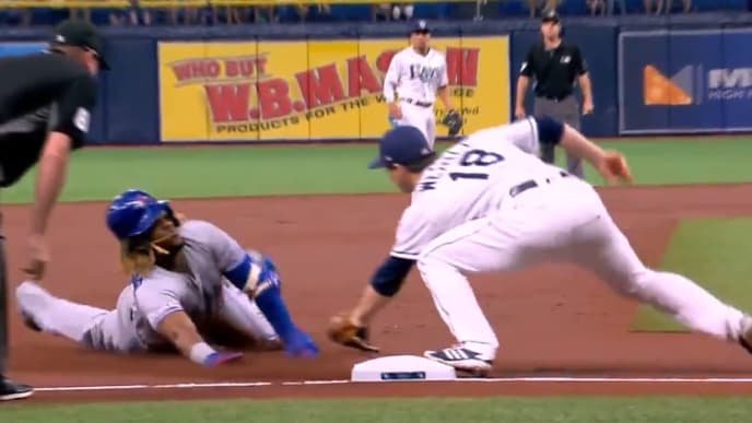 Vlad Guerrero Jr. dodges tag with swim move on Thursday against Rays.