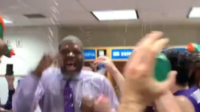 Evansville coach Walter McCarty celebrates after the team's upset win over No.1 Kentucky.