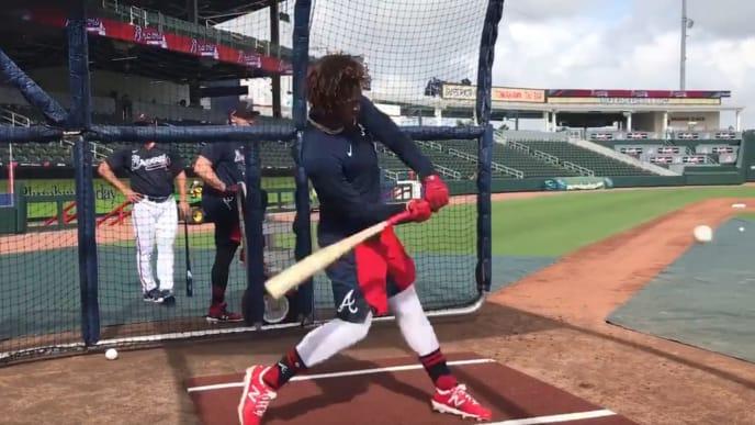 Atlanta Braves OF Ronald Acuña Jr. takes batting practice at spring training.