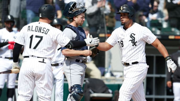 CHICAGO, ILLINOIS - APRIL 06: Right, Jose Abreu #79 of the Chicago White Sox shakes hands with Yonder Alonso #17 after hitting a solo home run during the fourth inning against the Seattle Mariners at Guaranteed Rate Field on April 06, 2019 in Chicago, Illinois. (Photo by Nuccio DiNuzzo/Getty Images)