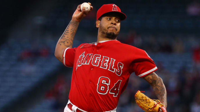 ANAHEIM, CALIFORNIA - APRIL 19: Pitcher Felix Pena #64 of the Los Angeles Angels of Anaheim pitches in the first inning during the MLB game against the Seattle Mariners at Angel Stadium of Anaheim on April 19, 2019 in Anaheim, California. (Photo by Victor Decolongon/Getty Images)