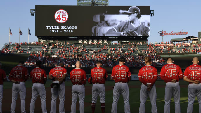 ANAHEIM, CA - JULY 12: The Los Angeles Angels of Anaheim stand for a moment of silence before they play the Seattle Mariners at Angel Stadium of Anaheim on July 12, 2019 in Anaheim, California. The entire Angels team wore #45 on their jersey to honor Skaggs who died on July 1. (Photo by John McCoy/Getty Images)