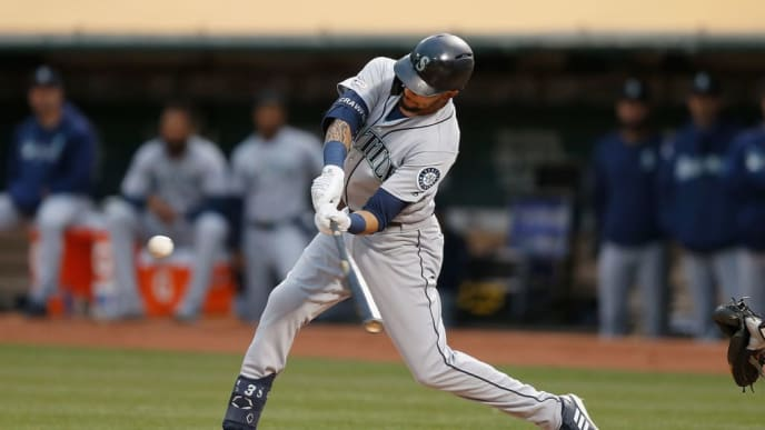 OAKLAND, CALIFORNIA - JUNE 14: J.P. Crawford #3 of the Seattle Mariners hits a two-run double in the top of the fourth inning against the Oakland Athletics at Ring Central Coliseum on June 14, 2019 in Oakland, California. (Photo by Lachlan Cunningham/Getty Images)