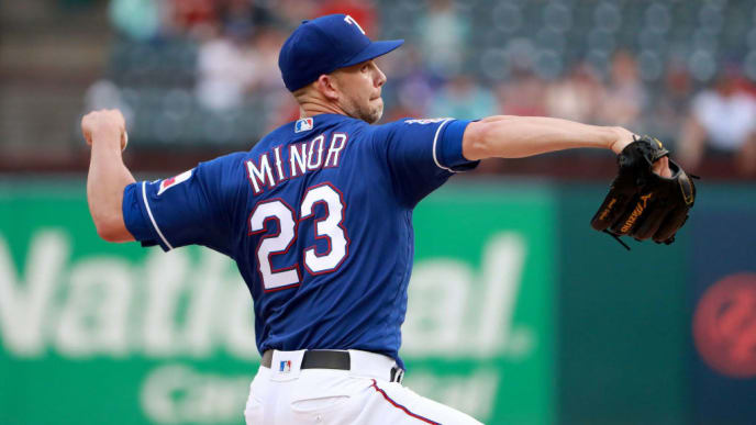 ARLINGTON, TEXAS - MAY 20: Mike Minor #23 of the Texas Rangers pitches against the Seattle Mariners in the \top of the first inning at Globe Life Park in Arlington on May 20, 2019 in Arlington, Texas. (Photo by Tom Pennington/Getty Images)