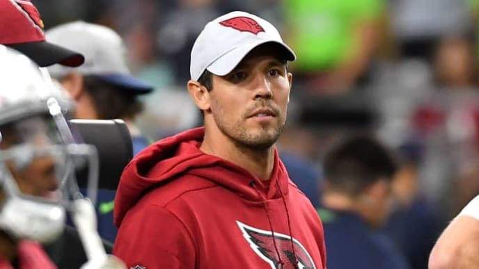 GLENDALE, AZ - SEPTEMBER 30: Quarterback Sam Bradford #9 of the Arizona Cardinals watches warm ups in street clothes before the game against the Seattle Seahawks at State Farm Stadium on September 30, 2018 in Glendale, Arizona. (Photo by Norm Hall/Getty Images)