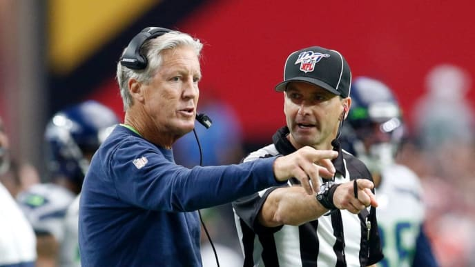 GLENDALE, ARIZONA - SEPTEMBER 29: Head coach Pete Carroll of the Seattle Seahawks talks with an official during the first half of the NFL football game against the Arizona Cardinals at State Farm Stadium on September 29, 2019 in Glendale, Arizona. (Photo by Ralph Freso/Getty Images)