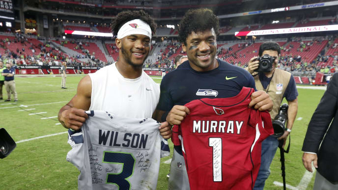 GLENDALE, ARIZONA - SEPTEMBER 29:  Quarterbacks Kyler Murray #1 of the Arizona Cardinals (L) and Russell Wilson #3 of the Seattle Seahawks swap signed jerseys following the NFL football game at State Farm Stadium on September 29, 2019 in Glendale, Arizona. The Seahawks defeated the Cardinals 27-10. (Photo by Ralph Freso/Getty Images)