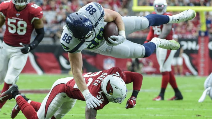 GLENDALE, ARIZONA - SEPTEMBER 29: Tight end Will Dissly #88 of the Seattle Seahawks is tackled by strong safety Budda Baker #32 of the Arizona Cardinals in the first half of the NFL game at State Farm Stadium on September 29, 2019 in Glendale, Arizona. (Photo by Jennifer Stewart/Getty Images)