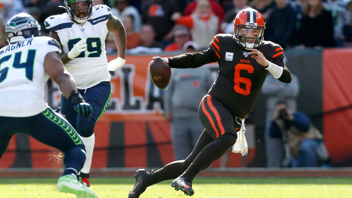 CLEVELAND, OH - OCTOBER 13:  Baker Mayfield #6 of the Cleveland Browns attempts to run the ball past Bobby Wagner #54 of the Seattle Seahawks during the third quarter at FirstEnergy Stadium on October 13, 2019 in Cleveland, Ohio. Seattle defeated Cleveland 32-28. (Photo by Kirk Irwin/Getty Images)
