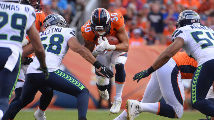 DENVER, CO - SEPTEMBER 9:  Jordan Moore #30 of the Denver Broncos runs for a first down against the Seattle Seahawks at Broncos Stadium at Mile High on September 9, 2018 in {Denver, Colorado. (Photo by Bart Young/Getty Images)