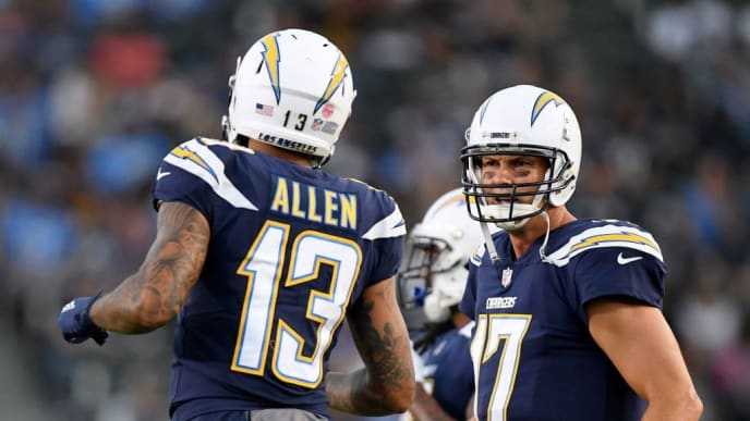 CARSON, CA - AUGUST 18:  Philip Rivers #17 and Keenan Allen #13 of the Los Angeles Chargers talk as they take the field during a presseason game against the Seattle Seahawks at StubHub Center on August 18, 2018 in Carson, California.  (Photo by Harry How/Getty Images)