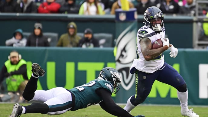PHILADELPHIA, PA - NOVEMBER 24: Rasul Douglas #32 of the Philadelphia Eagles attempts to tackle Rashaad Penny #20 of the Seattle Seahawks during the fourth quarter at Lincoln Financial Field on November 24, 2019 in Philadelphia, Pennsylvania. The Seahawks defeated the Eagles 17-9. (Photo by Corey Perrine/Getty Images)