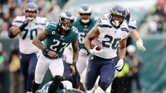 PHILADELPHIA, PENNSYLVANIA - NOVEMBER 24:  Rashaad Penny #20 of the Seattle Seahawks runs the ball for touchdown in the fourth quarter as Ronald Darby #21Malcolm Jenkins #27 of the Philadelphia Eagles defends at Lincoln Financial Field on November 24, 2019 in Philadelphia, Pennsylvania.The Seattle Seahawks defeated the Philadelphia Eagles 17-9. (Photo by Elsa/Getty Images)