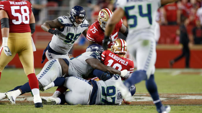 SANTA CLARA, CA - NOVEMBER 11: Jarran Reed #91 and  Poona Ford #97 of the Seattle Seahawks sack Jimmy Garoppolo #10 of the San Francisco 49ers during the game at Levi's Stadium on November 11, 2019 in Santa Clara, California. The Seahawks defeated the 49ers 27-24. (Photo by Michael Zagaris/San Francisco 49ers/Getty Images)