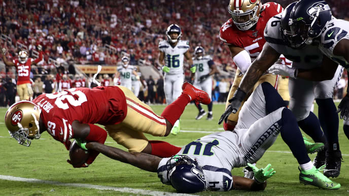 SANTA CLARA, CALIFORNIA - NOVEMBER 11: Strong safety Jaquiski Tartt #29 of the San Francisco 49ers strips the ball  from wide receiver D.K. Metcalf #14 of the Seattle Seahawks at the two yard line to prevent a Seattle Seahawks touchdown in the second quarter at Levi's Stadium on November 11, 2019 in Santa Clara, California. (Photo by Ezra Shaw/Getty Images)