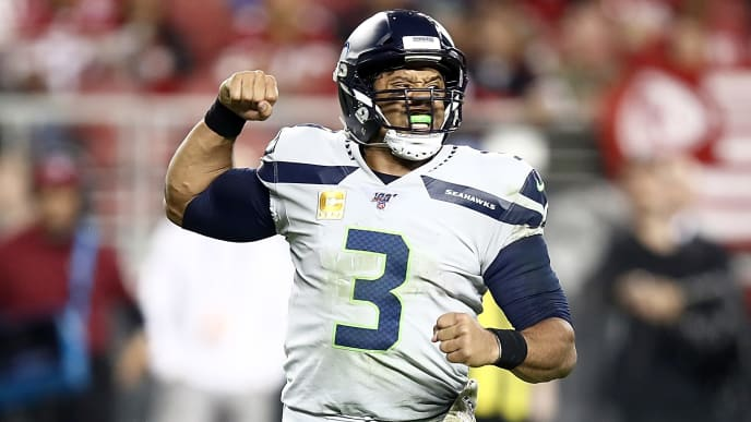SANTA CLARA, CALIFORNIA - NOVEMBER 11: Quarterback Russell Wilson #3 of the Seattle Seahawks celebrates the touchdown by running back Chris Carson #32 in the third quarter against the San Francisco 49ers  at Levi's Stadium on November 11, 2019 in Santa Clara, California. (Photo by Ezra Shaw/Getty Images)