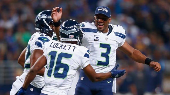 ST. LOUIS, MO - SEPTEMBER 13: Tyler Lockett #16 and Russell Wilson #3 both of the Seattle Seahawks celebrates a punt return for a touchdown against the St. Louis Rams in the first quarter at the Edward Jones Dome on September 13, 2015 in St. Louis, Missouri. (Photo by Jamie Squire/Getty Images)