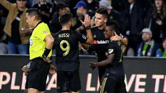 LOS ANGELES, CALIFORNIA - OCTOBER 29:  Eduard Atuesta #20 of Los Angeles FC celebrates his goal with Latif Blessing #7 and Diego Rossi #9 to tie the game 1-1 with the Seattle Sounders during the first half during the Western Conference finals at Banc of California Stadium on October 29, 2019 in Los Angeles, California. (Photo by Harry How/Getty Images)