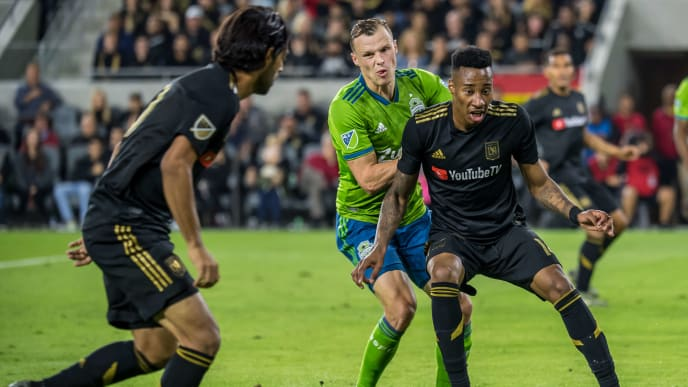 LOS ANGELES, CA - OCTOBER 29:  Mark-Anthony Kaye #14 of Los Angeles FC passes to Carlos Vela #10 of Los Angeles FC during the MLS Western Conference Final between Los Angeles FC and Seattle Sounders at the Banc of California Stadium on October 29, 2019 in Los Angeles, California.  Seattle Sounders won the match 3-1 (Photo by Shaun Clark/Getty Images)