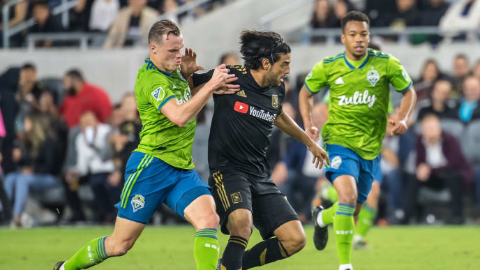 LOS ANGELES, CA - OCTOBER 29: Carlos Vela #10 of Los Angeles FC battles Brad Smith #11 of Seattle Sounders during the MLS Western Conference Final between Los Angeles FC and Seattle Sounders at the Banc of California Stadium on October 29, 2019 in Los Angeles, California.  Seattle Sounders won the match 3-1 (Photo by Shaun Clark/Getty Images)