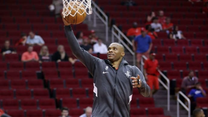 HOUSTON, TEXAS - SEPTEMBER 30: Russell Westbrook #0 of the Houston Rockets drives to the basket for a layup as he warms up before a pre-season game against the Shanghai Sharks at Toyota Center on September 30, 2019 in Houston, Texas. NOTE TO USER: User expressly acknowledges and agrees that, by downloading and/or using this photograph, user is consenting to the terms and conditions of the Getty Images License Agreement.  (Photo by Bob Levey/Getty Images)