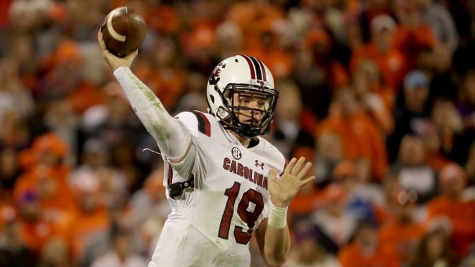 CLEMSON, SC - NOVEMBER 24:  Jake Bentley #19 of the South Carolina Gamecocks drops back to pass against the Clemson Tigers during their game at Clemson Memorial Stadium on November 24, 2018 in Clemson, South Carolina.  (Photo by Streeter Lecka/Getty Images)