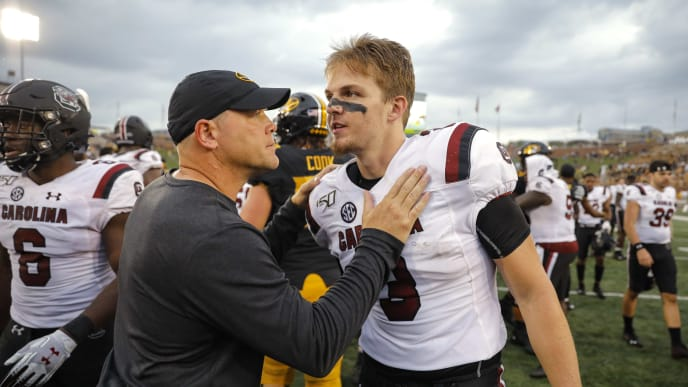 COLUMBIA, MO - SEPTEMBER 21: Head coach Barry Odom of the Missouri Tigers speaks to quarterback Ryan Hilinski #3 of the South Carolina Gamecocks after the Missouri 34-14 victory at Faurot Field/Memorial Stadium on September 21, 2019 in Columbia, Missouri. (Photo by David Eulitt/Getty Images)