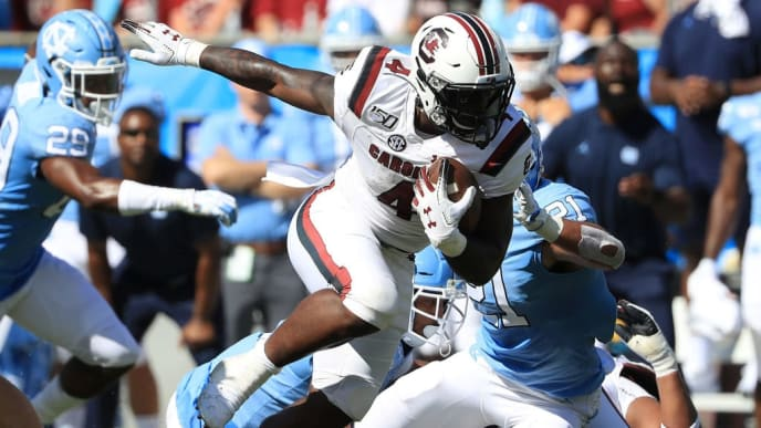 CHARLOTTE, NORTH CAROLINA - AUGUST 31: Tavien Feaster #4 of the South Carolina Gamecocks runs for a touchdown against the North Carolina Tar Heels during the Belk College Kickoff game at Bank of America Stadium on August 31, 2019 in Charlotte, North Carolina. (Photo by Streeter Lecka/Getty Images)