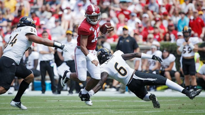 TUSCALOOSA, AL - SEPTEMBER 21: Tua Tagovailoa #13 of the Alabama Crimson Tide scrambles for a first down in the third quarter against the Southern Mississippi Golden Eagles at Bryant-Denny Stadium on September 21, 2019 in Tuscaloosa, Alabama. Alabama defeated Southern Miss 49-7. (Photo by Joe Robbins/Getty Images)