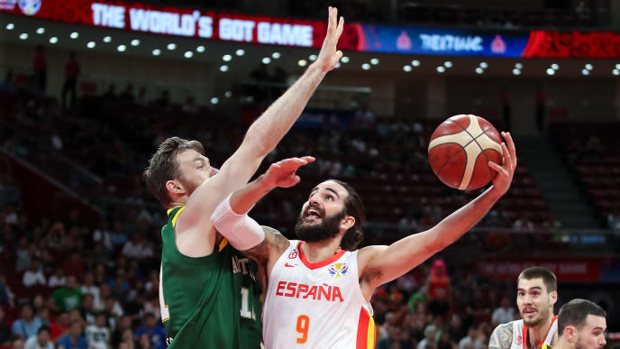 BEIJING, CHINA - SEPTEMBER 13:  Ricky Rubio #9 of Spain drives against  Aron Baynes of Australia during the semi-finals of 2019 FIBA World Cup match between Spain and Australia at Beijing Wukesong Sport Arena on September 13, 2019 in Beijing, China.  (Photo by Lintao Zhang/Getty Images)