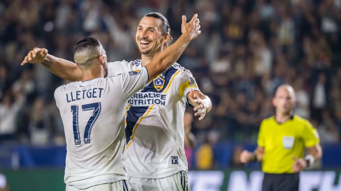 CARSON, CA -SEPTEMBER 15: Sebastian Lletget #17 of Los Angeles Galaxy celebrates his first goal with Zlatan Ibrahimovic #9 of Los Angeles Galaxy during the Los Angeles Galaxy's MLS match against Sporting KC at the Dignity Health Sports Park on September 15, 2019 in Carson, California.  Los Angeles Galaxy won the match 7-2 (Photo by Shaun Clark/Getty Images)