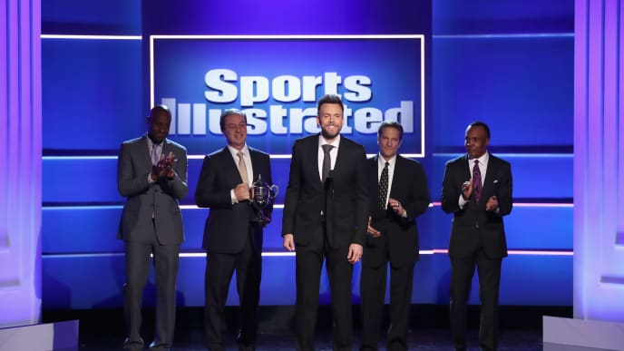 BEVERLY HILLS, CA - DECEMBER 11:  (L-R) Jerry Rice, Joe Lacob, Joel McHale, Peter Guber and Sugar Ray Leonard speak onstage during Sports Illustrated 2018 Sportsperson of the Year Awards Show on Tuesday, December 11, 2018 at The Beverly Hilton in Los Angeles. Tune in to NBCSN on Thursday, December 13, 2018 at 9pmET to watch the one hour Sports Illustrated Sportsperson of the Year Awards special.  (Photo by Rich Polk/Getty Images for Sports Illustrated)