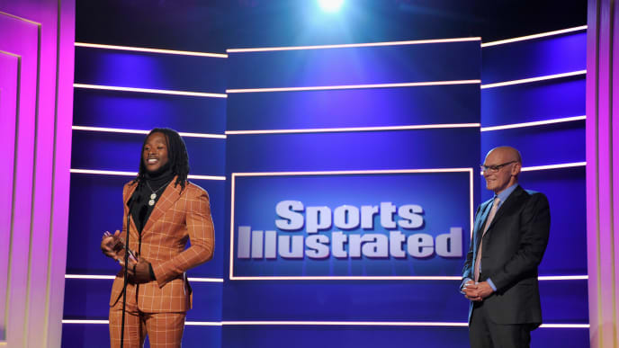 """BEVERLY HILLS, CA - DECEMBER 11:  Alvin Kamara accepts the """"Breakout of the Year"""" award from James Carville onstage during Sports Illustrated 2018 Sportsperson of the Year Awards Show on Tuesday, December 11, 2018 at The Beverly Hilton in Los Angeles. Tune in to NBCSN on Thursday, December 13, 2018 at 9pmET to watch the one hour Sports Illustrated Sportsperson of the Year Awards special.  (Photo by John Sciulli/Getty Images for Sports Illustrated)"""