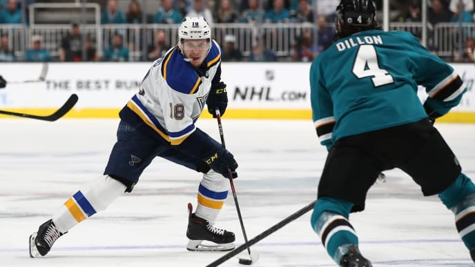 SAN JOSE, CALIFORNIA - MAY 13: Robert Thomas #18 of the St. Louis Blues controls the ball against Brenden Dillon #4 of the San Jose Sharks in Game Two of the Western Conference Final during the 2019 NHL Stanley Cup Playoffs at SAP Center on May 13, 2019 in San Jose, California. (Photo by Ezra Shaw/Getty Images)