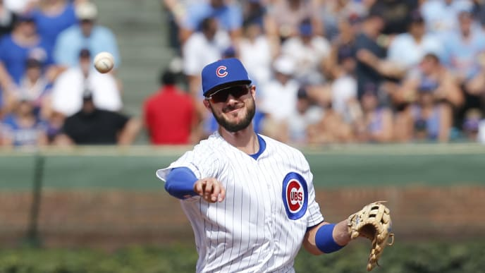 CHICAGO, ILLINOIS - SEPTEMBER 20: Kris Bryant #17 of the Chicago Cubs throws to first base to get Dexter Fowler #25 of the St. Louis Cardinals out during the first inning of a game at Wrigley Field on September 20, 2019 in Chicago, Illinois. (Photo by Nuccio DiNuzzo/Getty Images)