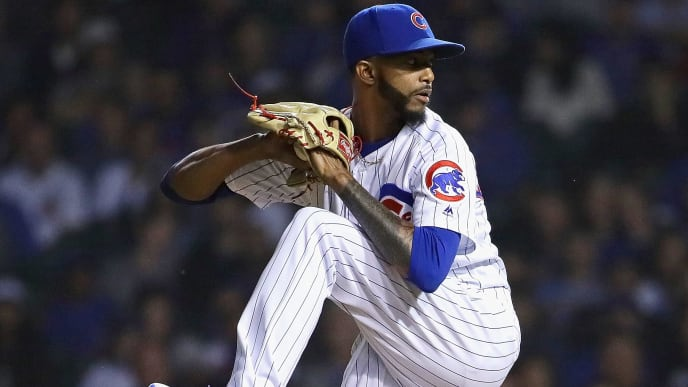 CHICAGO, ILLINOIS - JUNE 09: Carl Edwards Jr. #6 of the Chicago Cubs pitches against the St. Louis Cardinals at Wrigley Field on June 09, 2019 in Chicago, Illinois. The Cubs defeated the Cardinals 5-1. (Photo by Jonathan Daniel/Getty Images)