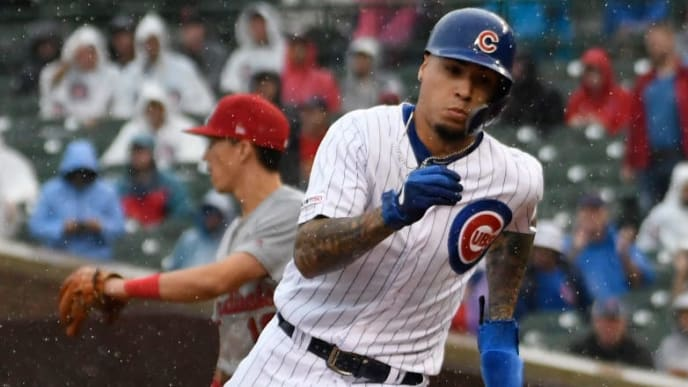 CHICAGO, ILLINOIS - SEPTEMBER 22: Javier Baez #9 of the Chicago Cubs runs to third base against the St. Louis Cardinals during the eighth inning at Wrigley Field on September 22, 2019 in Chicago, Illinois. (Photo by David Banks/Getty Images)