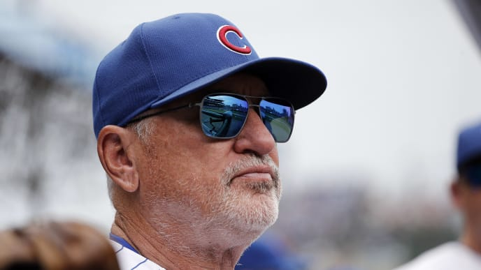 CHICAGO, ILLINOIS - SEPTEMBER 21: Manager Joe Maddon #70 of the Chicago Cubs stands in the dugout  during the game  against the St. Louis Cardinals at Wrigley Field on September 21, 2019 in Chicago, Illinois. (Photo by Nuccio DiNuzzo/Getty Images)