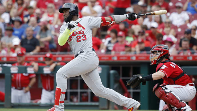 CINCINNATI, OH - JUNE 10: Marcell Ozuna #23 of the St. Louis Cardinals singles to deep left field to drive in a run in the third inning against the Cincinnati Reds at Great American Ball Park on June 10, 2018 in Cincinnati, Ohio. (Photo by Joe Robbins/Getty Images)