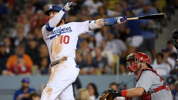 LOS ANGELES, CALIFORNIA - AUGUST 05:  Justin Turner #10 of the Los Angeles Dodgers hits a double in front of Matt Wieters #32 of the St. Louis Cardinals to score Max Muncy #13, to take a 6-0 lead, during the fourth inning at Dodger Stadium on August 05, 2019 in Los Angeles, California. (Photo by Harry How/Getty Images)