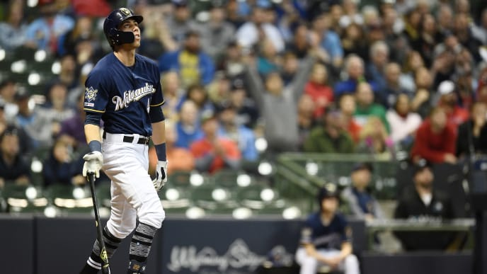 MILWAUKEE, WISCONSIN - APRIL 15:  Christian Yelich #22 of the Milwaukee Brewers hits a three-run home run during the sixth inning of a game against the St. Louis Cardinals at Miller Park on April 15, 2019 in Milwaukee, Wisconsin. All players are wearing the number 42 in honor of Jackie Robinson Day. (Photo by Stacy Revere/Getty Images)