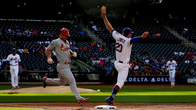 NEW YORK, NEW YORK - JUNE 14:  Paul Goldschmidt #46 of the St. Louis Cardinals grounds into a double play as Pete Alonso #20 of the New York Mets leaps for the ball in the tenth inning at Citi Field on June 14, 2019 in New York City. (Photo by Mike Stobe/Getty Images)