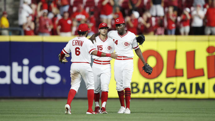 CINCINNATI, OH - AUGUST 17: Aristides Aquino #44, Nick Senzel #15 and Phillip Ervin #6 of the Cincinnati Reds celebrate after the game against the St. Louis Cardinals at Great American Ball Park on August 17, 2019 in Cincinnati, Ohio. The Reds won 6-1. (Photo by Joe Robbins/Getty Images)