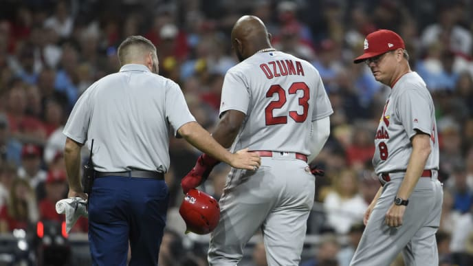 SAN DIEGO, CA - JUNE 28: Marcell Ozuna #23 of the St. Louis Cardinals leaves the game with a trainer as Mike Shildt #8 looks on during the third inning of a baseball game against the San Diego Padres at Petco Park June 28, 2019 in San Diego, California.  (Photo by Denis Poroy/Getty Images)