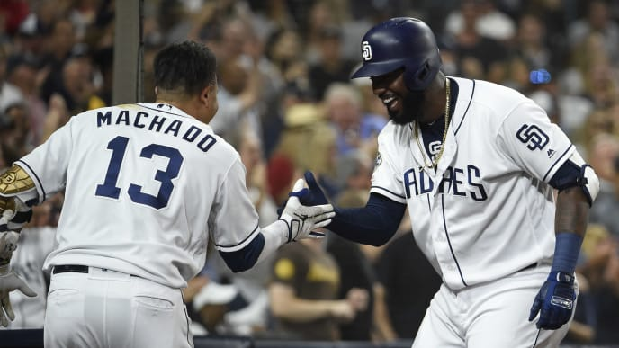 SAN DIEGO, CA - JUNE 29: Franmil Reyes #32 of the San Diego Padres, right, is congratulated by Manny Machado #13 after hitting a solo home run during the second inning of a baseball game against the St. Louis Cardinals at Petco Park June 29, 2019 in San Diego, California.  (Photo by Denis Poroy/Getty Images)