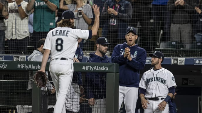 SEATTLE, WA - JULY 3: Starting pitcher Mike Leake #8 of the Seattle Mariners acknowledges fans and teammates including Yusei Kikuchi #18 of the Seattle Mariners (2R) after coming off the fiel during the eighth inning of a game against the St. Louis Cardinals at T-Mobile Park on July 3, 2019 in Seattle, Washington. The Cardinals won the game 5-2. (Photo by Stephen Brashear/Getty Images)