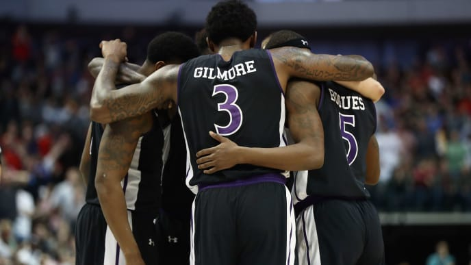 DALLAS, TX - MARCH 15:  Leon Gilmore III #3 of the Stephen F. Austin Lumberjacks huddles with teammates in the second half against the Texas Tech Red Raiders in the first round of the 2018 NCAA Men's Basketball Tournament at American Airlines Center on March 15, 2018 in Dallas, Texas. The Texas Tech Red Raiders won 70-60. (Photo by Ronald Martinez/Getty Images)